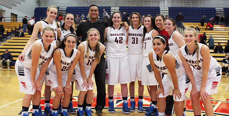 The Warrior women's basketball team poses with Twin Rivers Physical Therapy representative Greg Jose.